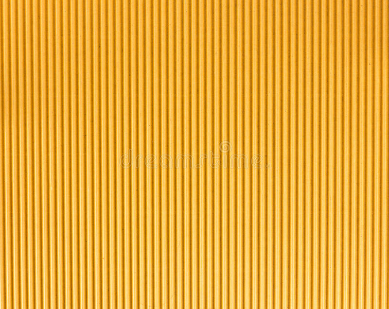 Corrugated fiberboard texture as background. Brown corrugated fiberboard texture background - rough surface royalty free stock images