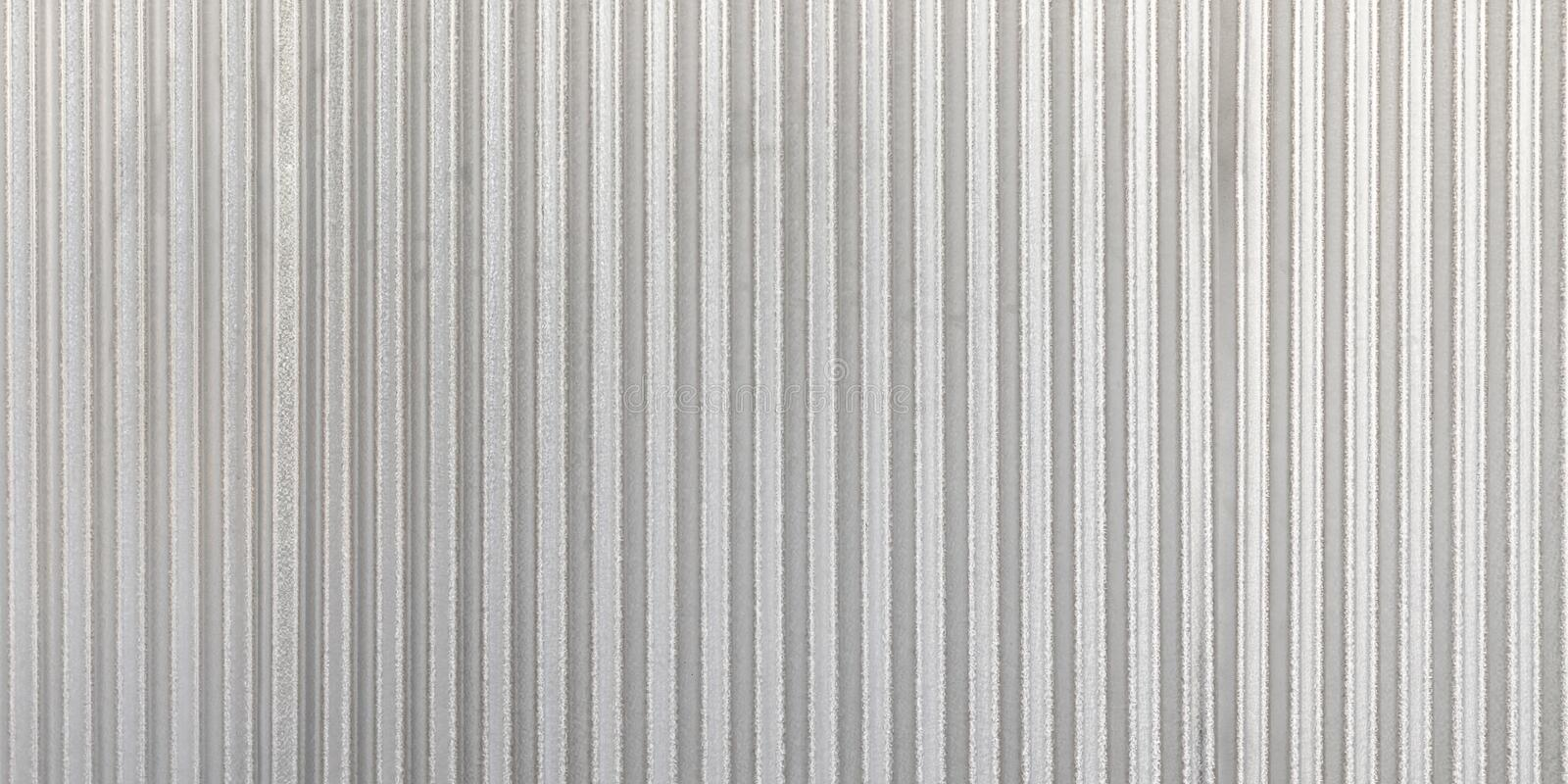 The corrugated grey metal panorama wall background. Rusty zinc grunge texture and background stock image