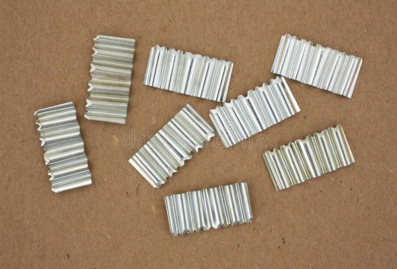 Corrugated joint fasteners on cardboard royalty free stock images