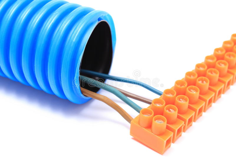 Corrugated pipe and cable with connection block. Corrugated plastic pipe and electrical cable with connection cube, component for use in installations. Isolated royalty free stock image