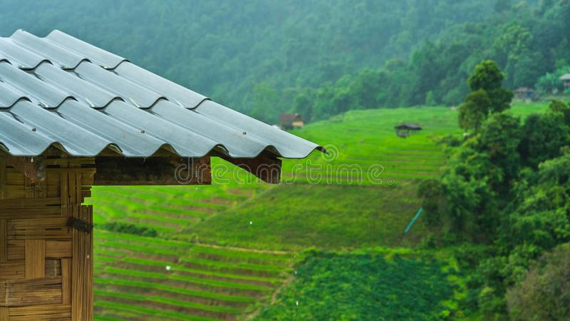 Roof House Natural Landscape Scenery. Corrugated Roof House With Natural Lush Green Mountain Landscape Scenery royalty free stock photos