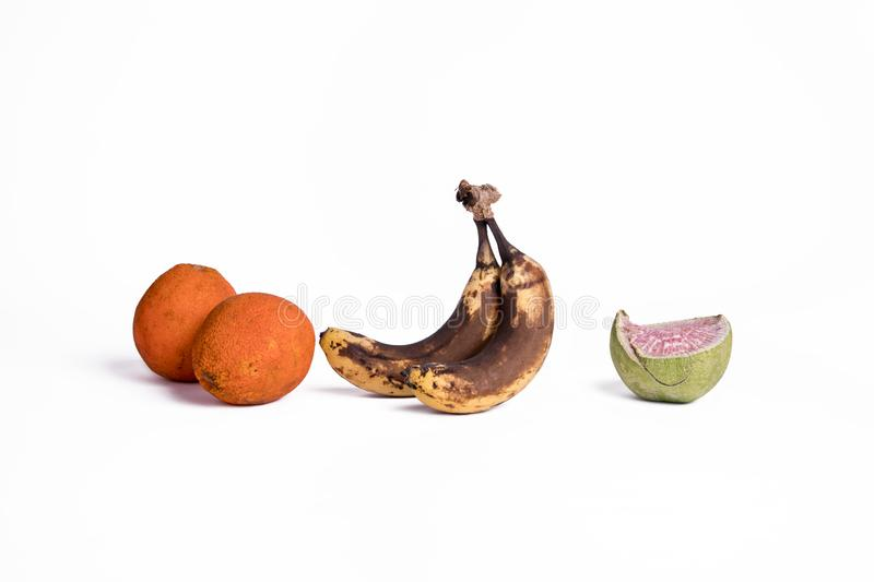 Corrupt fruit. Corrupt Stale Little moisture Aged Metamorphic Banana Fruits White bottom photos oranges radish stock photo