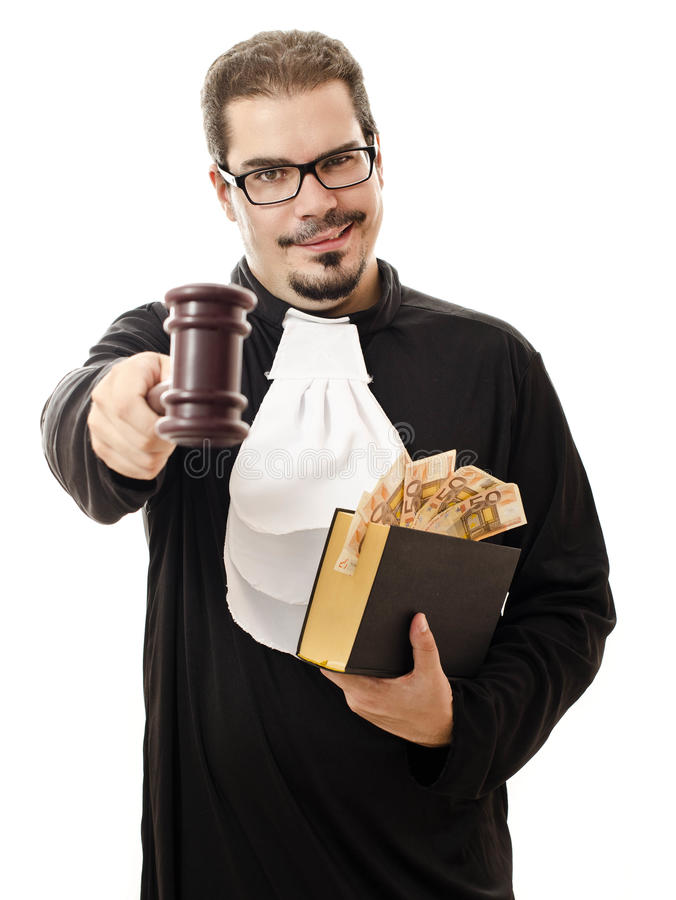 Corrupt judge with money and law. Portrait of corrupt judge with the law book and the money for a bribe isolated on white stock photos