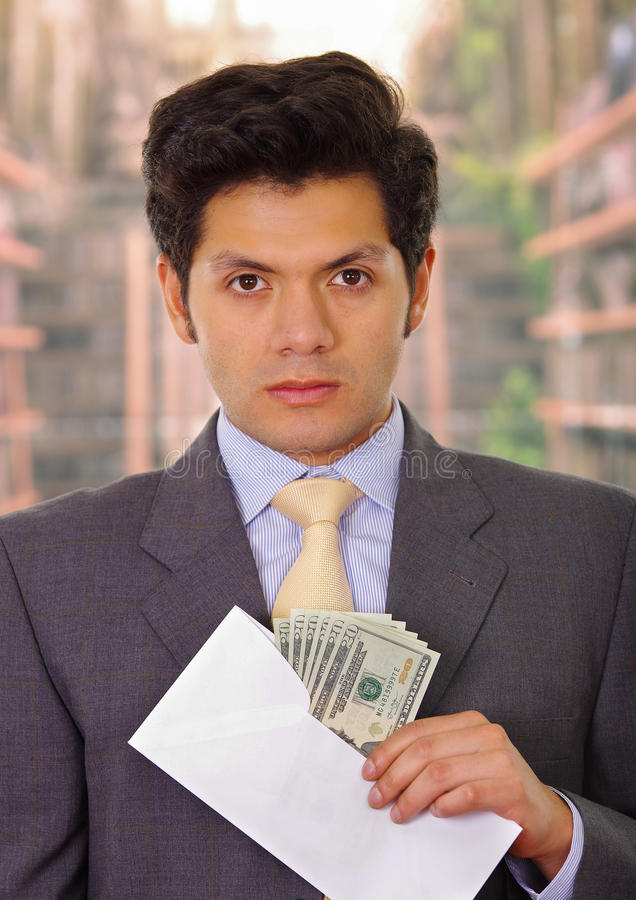 Corrupt politician put some money inside of an envelope.  stock images