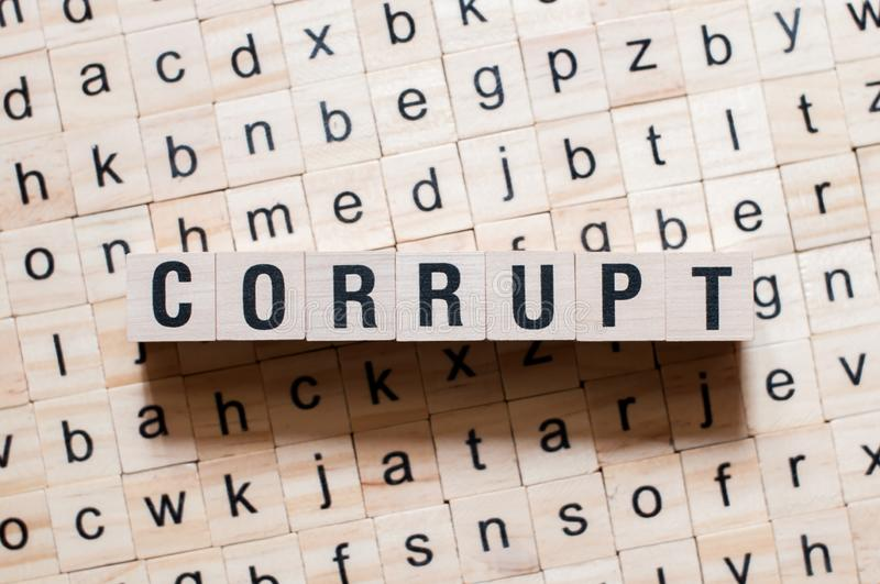 Corrupt word concept. On cubes royalty free stock photography