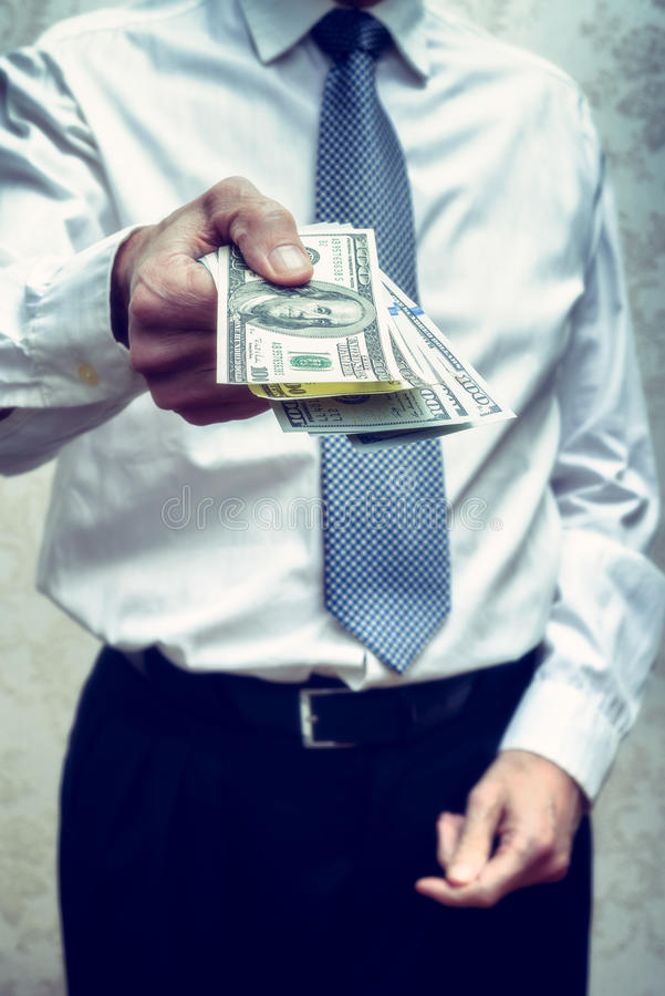 Corrupted businessman, or politician, offering a Dollar banknote. S bribe royalty free stock photography