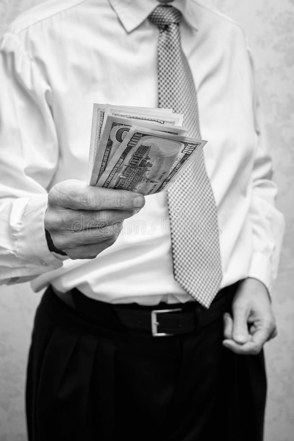 Corrupted businessman, or politician, offering a Dollar banknotes. Bribe stock images