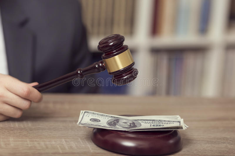 Corrupted judge. Detail of a corrupted judge saying a verdict on court. Selective focus royalty free stock image
