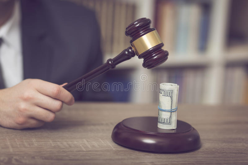 Corrupted judge. Detail of a corrupted judge saying a verdict on court. Selective focus stock photo