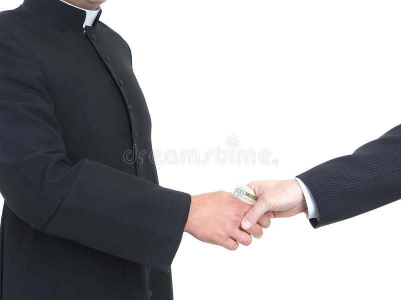 Corruptible priest. Catholic priest receiving bribe from businessman royalty free stock images