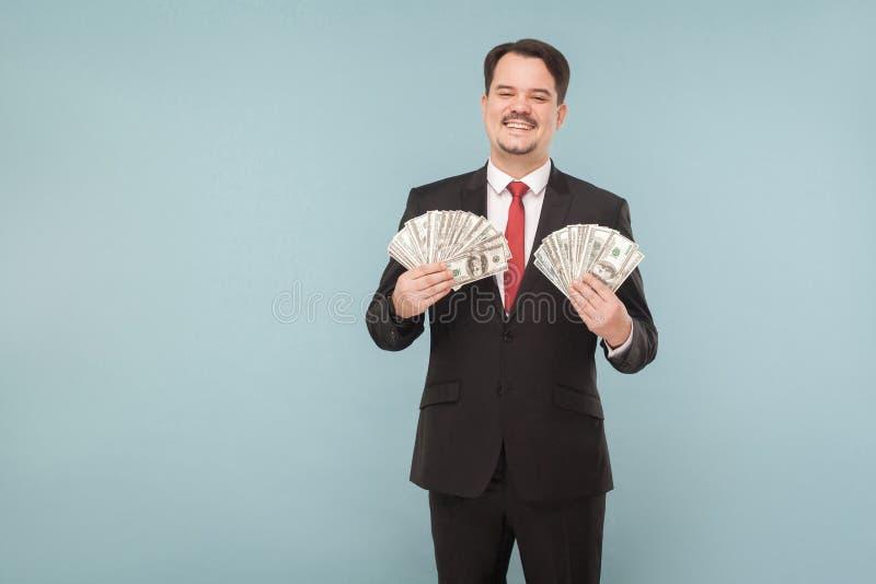 Corruptie, maffia, het werkconcept Mens die in kostuum vele dolla houden stock fotografie