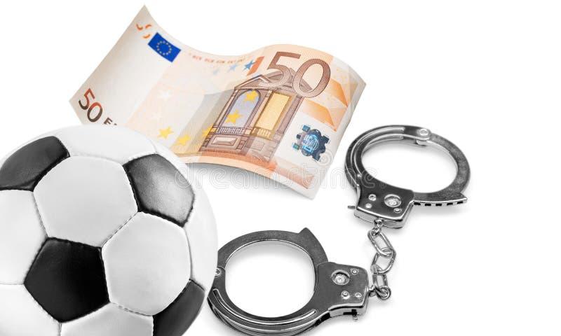 Corruptie op voetbal stock foto
