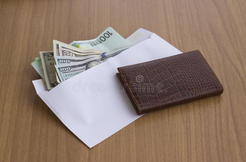 Corruption and bribery. Money in an envelope for signing the document stock image