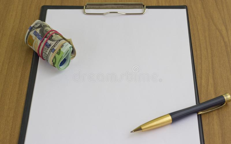 Corruption and bribery. Money in an envelope for signing the document royalty free stock photos