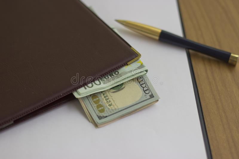 Corruption and bribery. Money in an envelope for signing the document royalty free stock images