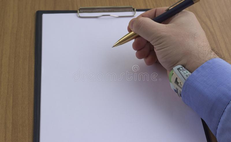 Corruption and bribery. Money in an envelope for signing the document stock photography