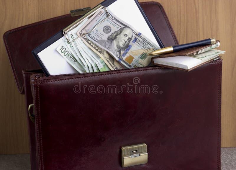 Corruption and bribery. Money in the portfolio of the corrupt stock photos