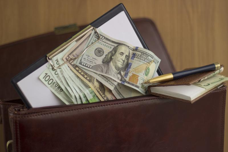Corruption and bribery. Money in the portfolio of the corrupt royalty free stock photo