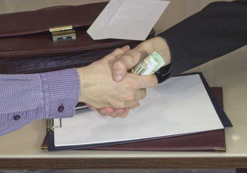 Corruption and bribery. The transfer of a bribe in the handshake stock photography