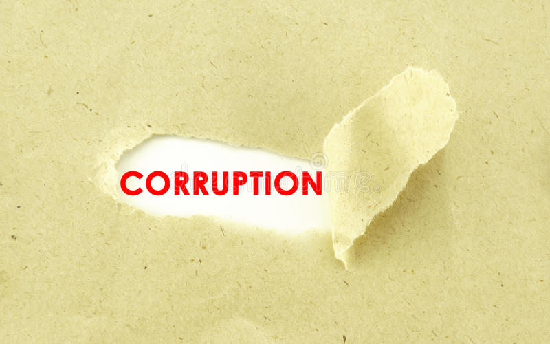 CORRUPTION. Text CORRUPTION appearing behind torn light brown envelop stock photo