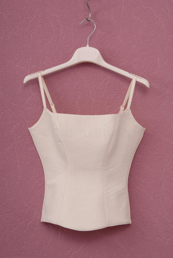 Corset is on magenta wall stock images