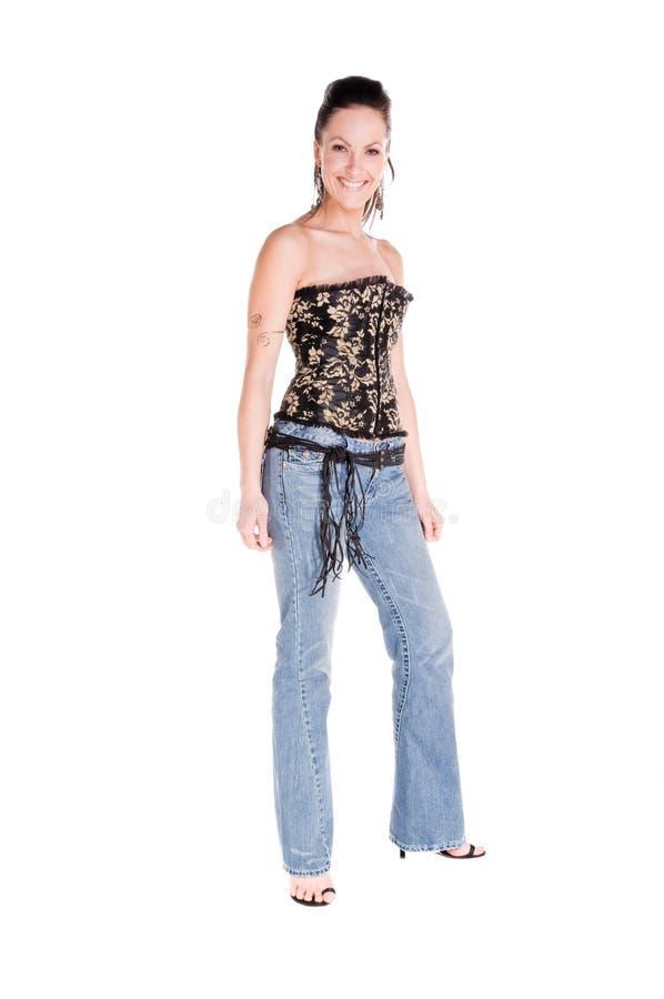 Corsetto e alte mode delle blue jeans immagini stock libere da diritti