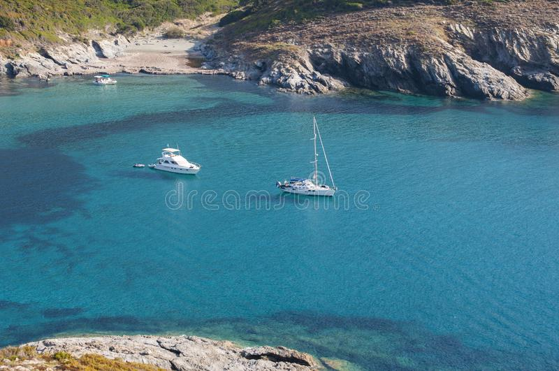 Plage d`Alisu, beach, Haute Corse, Cape Corse, Corsica, Upper Corsica, France, Europe, island. Corsica, 28/08/2017: boats in the crystal clear water of Anse d stock photos