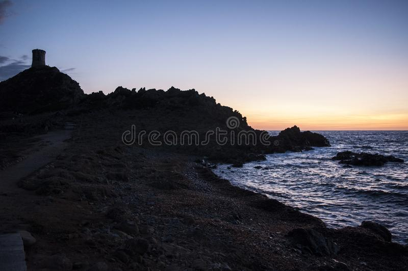 Iles Sanguinaires, Gulf of Ajaccio, Corsica, Corse, France, Europe, island. Corsica, 01/09/2017: breathtaking sunset on La Parata Tower, a ruined Genoese tower royalty free stock photography