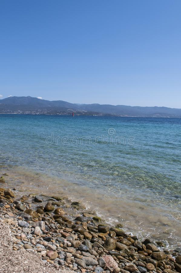 Ajaccio, beach, Corsica, Corse du Sud, Southern Corsica, France, Europe. Corsica, 01/09/2017: crystal clear water of the Mediterranean Sea at the urban beach of stock images