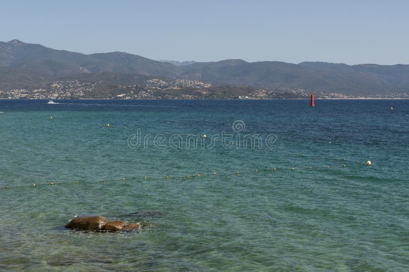 Ajaccio, beach, Corsica, Corse du Sud, Southern Corsica, France, Europe. Corsica, 01/09/2017: crystal clear water of the Mediterranean Sea at the urban beach of royalty free stock image