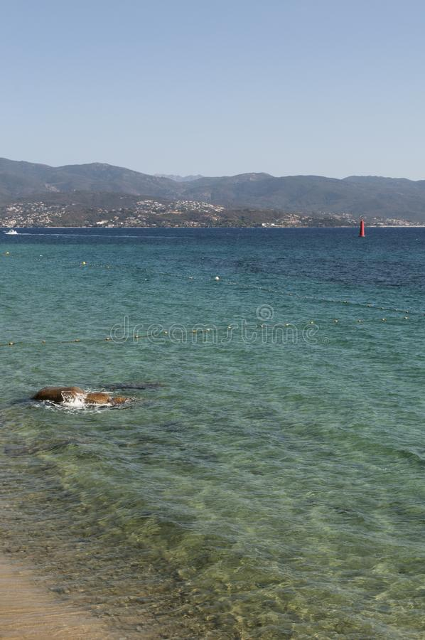 Ajaccio, beach, Corsica, Corse du Sud, Southern Corsica, France, Europe. Corsica, 01/09/2017: crystal clear water of the Mediterranean Sea at the urban beach of royalty free stock photos