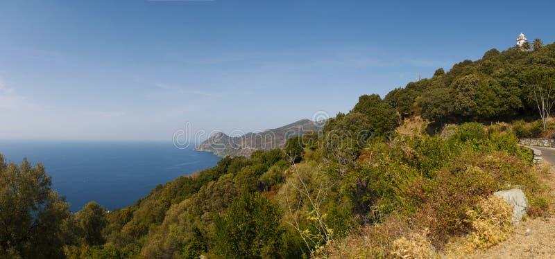 Canari, Haute Corse, Cape Corse, Corsica, Upper Corsica, France, Europe, island. Corsica, 28/08/2017: the Mediterranean maquis and the white bell tower in Canari royalty free stock photography