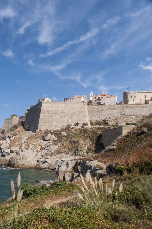 Calvi, Citadel, beach, ancient walls, marina, skyline, Corsica, Corse, France, Europe, island. Corsica, 03/09/2017: the Mediterranean Sea and view of the skyline royalty free stock image