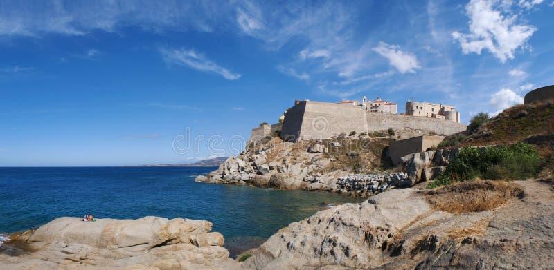 Calvi, Citadel, beach, ancient walls, marina, skyline, Corsica, Corse, France, Europe, island. Corsica, 03/09/2017: the Mediterranean Sea and view of the skyline stock image