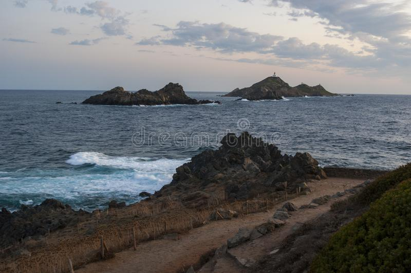 Iles Sanguinaires, Gulf of Ajaccio, Corsica, Corse, France, Europe, island. Corsica, 01/09/2017: rocks, waves and the Mediterranean Sea with view of the Iles royalty free stock photos