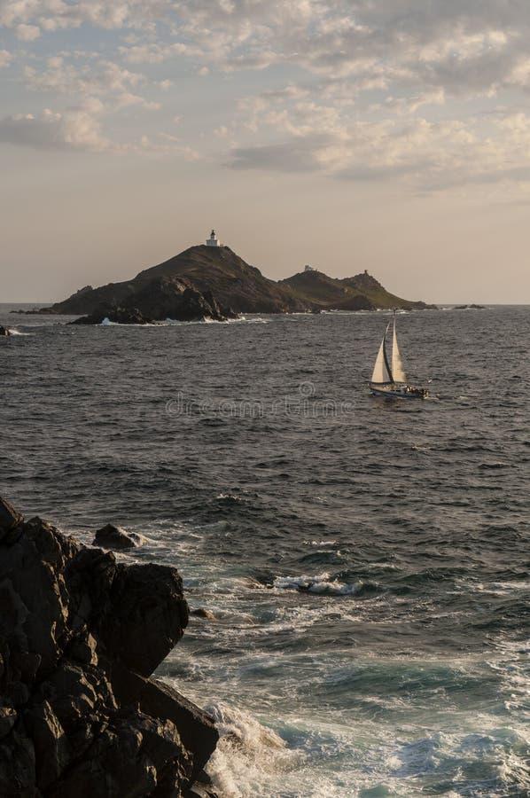 Iles Sanguinaires, Gulf of Ajaccio, Corsica, Corse, France, Europe, island. Corsica, 01/09/2017: a sailboat in the Mediterranean Sea with view of the Iles stock photos