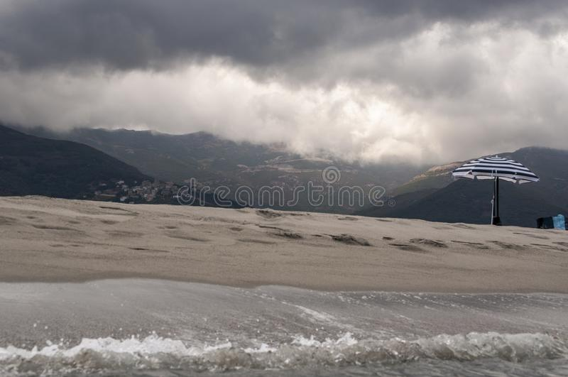 Stormy weather, beach, sea, skyline, mountain, Corsica, Haute Corse, France, Europe, island. Corsica, 06/09/2017: stormy weather on the beach of Furiani, little royalty free stock photo