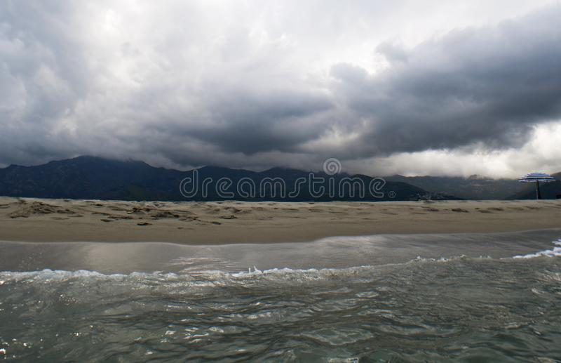 Stormy weather, beach, sea, skyline, mountain, Corsica, Haute Corse, France, Europe, island. Corsica, 06/09/2017: stormy weather on the beach of Furiani, little stock photos