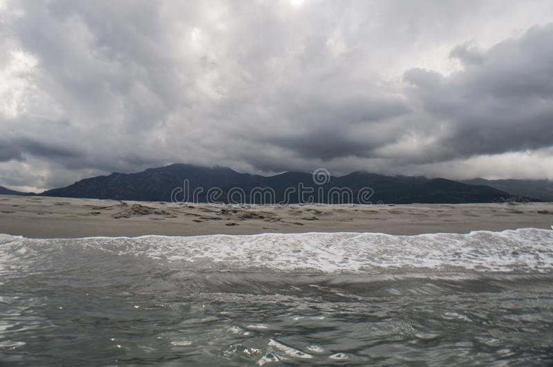 Stormy weather, beach, sea, skyline, mountain, Corsica, Haute Corse, France, Europe, island. Corsica, 06/09/2017: stormy weather on the beach of Furiani, little royalty free stock photos