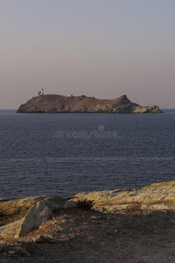 Ile de la Giraglia, Giraglia island, lighthouse, Barcaggio, Ersa, Cap Corse, Cape Corse, Haute-Corse, Corsica, France, Europe. Corsica, 29/08/2017: sunset on the royalty free stock photos