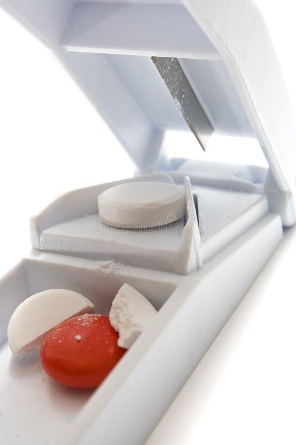 Cortador blanco de la píldora imagen de archivo libre de regalías