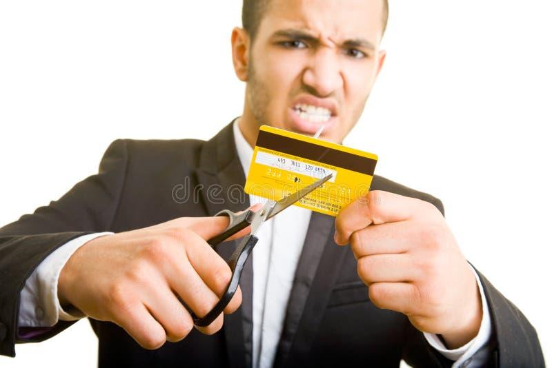 Cortando um cartão de crédito fotografia de stock