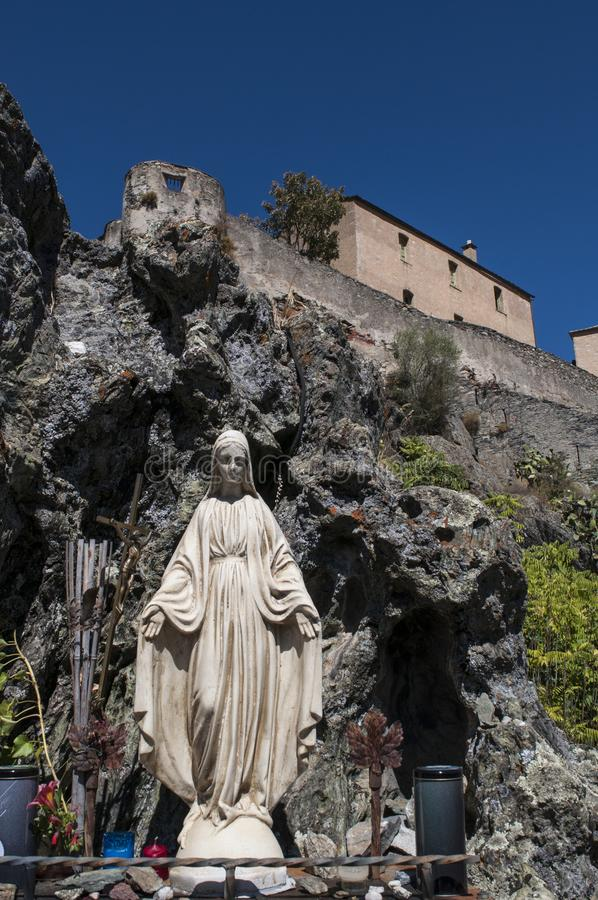 Corte, Citadel, perched, Corsica, Corse, Cap Corse, Upper Corse, France, Europe. Corsica, 31/08/2017: the public votive statue of the Virgin Mary, skyline and royalty free stock photo