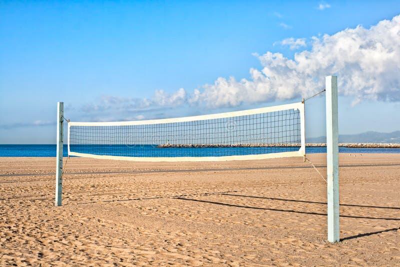 Corte de voleibol na praia fotografia de stock