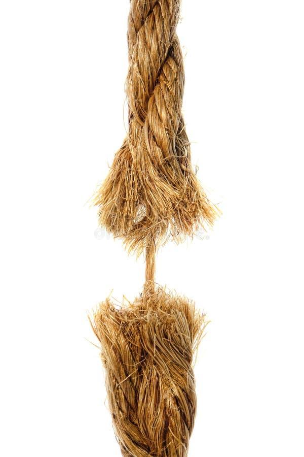 Corte la cuerda que cuelga por una cuerda de rosca fotos de archivo