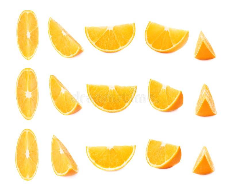 Corte la sección de la naranja aislada sobre el fondo blanco, sistema de diversos escorzos imagenes de archivo