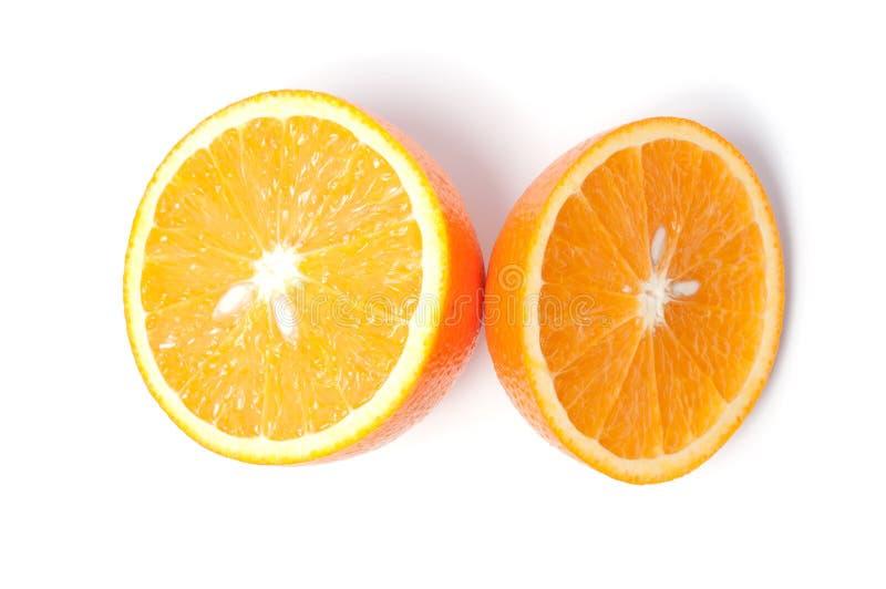 Corte a laranja no fundo branco imagem de stock royalty free