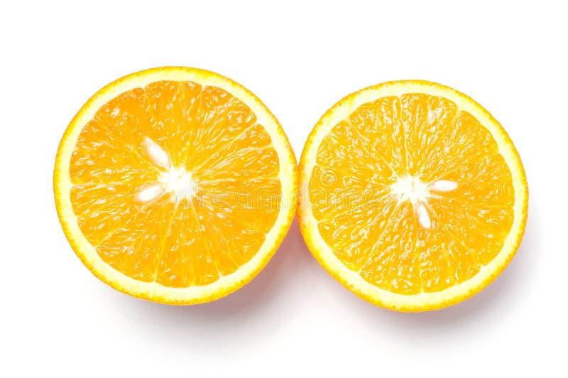 Corte a laranja no fundo branco foto de stock