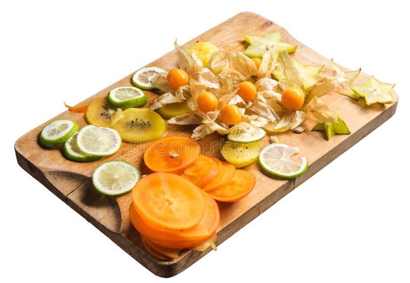 Corte los pedazos de fruta de KIWI, de Carambola y de caqui en boa del corte imágenes de archivo libres de regalías