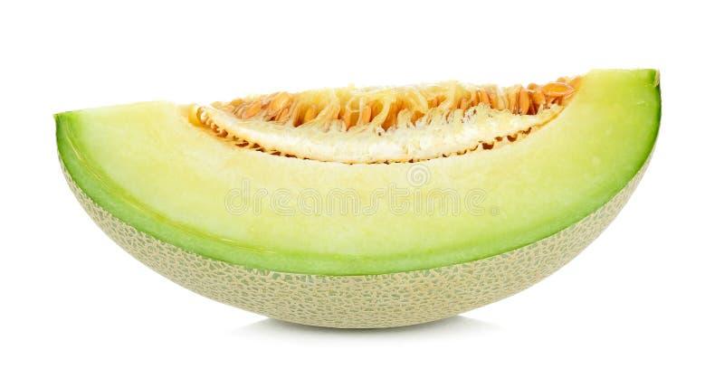 Corte o fruto do melão isolado no fundo branco imagem de stock